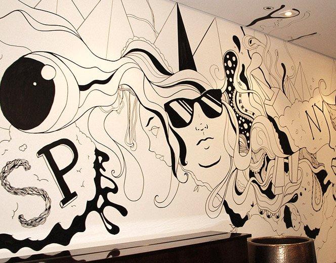 Ilustração na parede usando apenas canetão preto