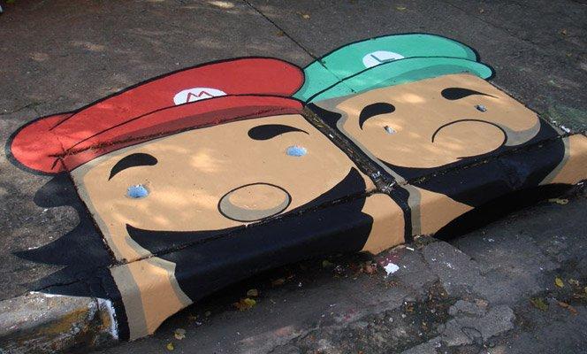 Street art em bueiros de rua