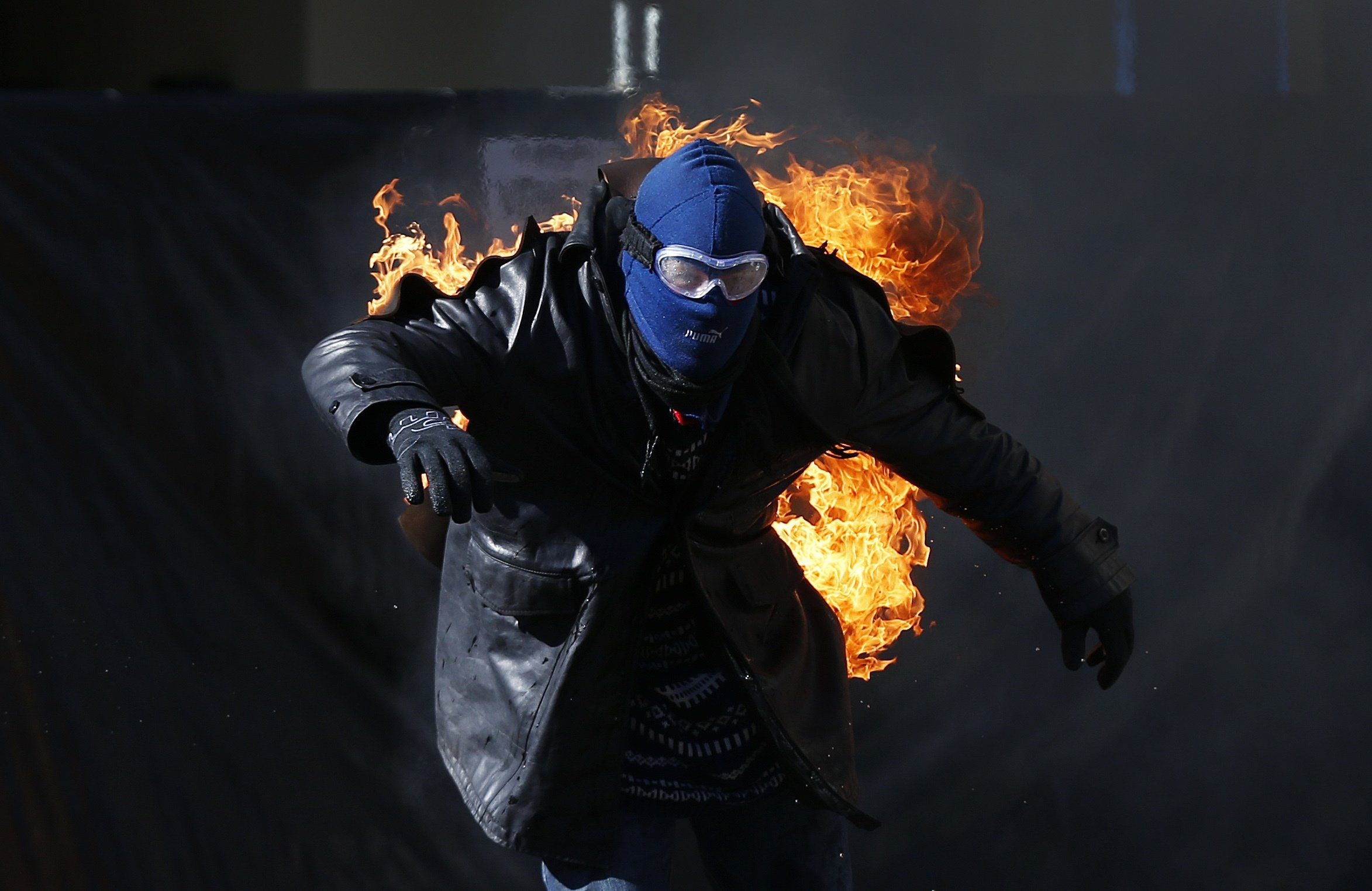 James performs a fire stunt during a publicity event at Luna Park in Sydney