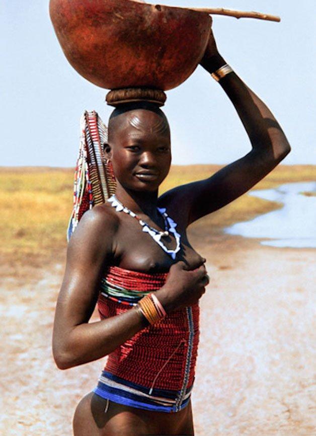 Dinka Woman with Corset Carrying Calabash
