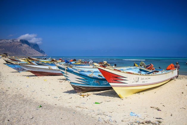 Colourful fishing boats in Qalansia on the west coast of the island of Socotra, UNESCO World Heritage Site, Yemen, Middle East