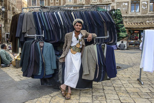 Man selling clothes in the Old Town, UNESCO World Heritage Site, Sanaa, Yemen, Middle East