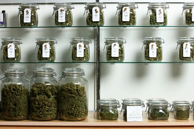 Lakewood, CO - MARCH, 4: Jars of medical cannabis line the shelves inside a Good Meds medical cannabis center in Lakewood, Colorado, U.S., on Monday, March 4, 2013. This is at a Good Meds medical cannabis center in Lakewood, and is one of the facilities that Kristi Kelly, Co-Founder of Good Meds Network, operates. (Photo by Matthew Staver/For The Washington Post)