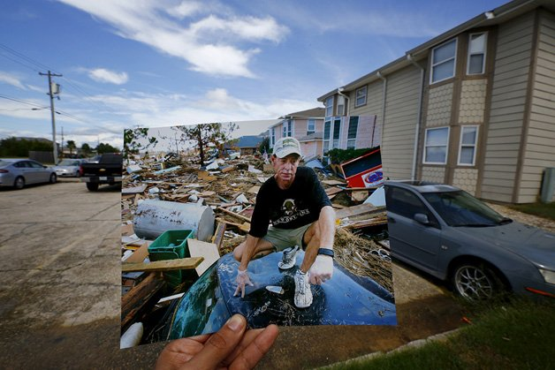 The print shows Michael Rehage squatting on the roof of his car, September 12, 2005.