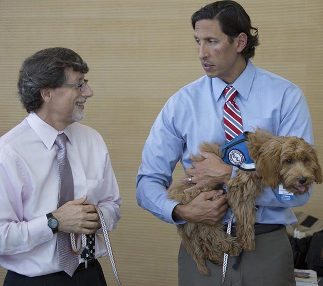 SACRAMENTO, Calif., August 17,  2015 Press conference at UC Davis Comprehensive Cancer Center introduces two dogs, Alfie and Charlie, that are being trained to help screen patients for cancer, August 17, 2015. Photo by Robert Durell