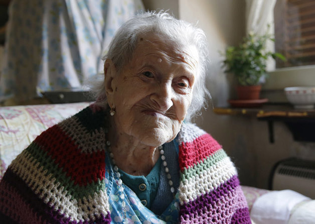 In this Friday, June 26, 2015 photo, Emma Morano, 115, sits in her apartment in Verbania, Italy. Morano and Susannah Mushatt Jones, also 115, of the Brooklyn borough of New York, are believed to be the last two people in the world with birthdates in the 1800s. (AP Photo/Antonio Calanni)