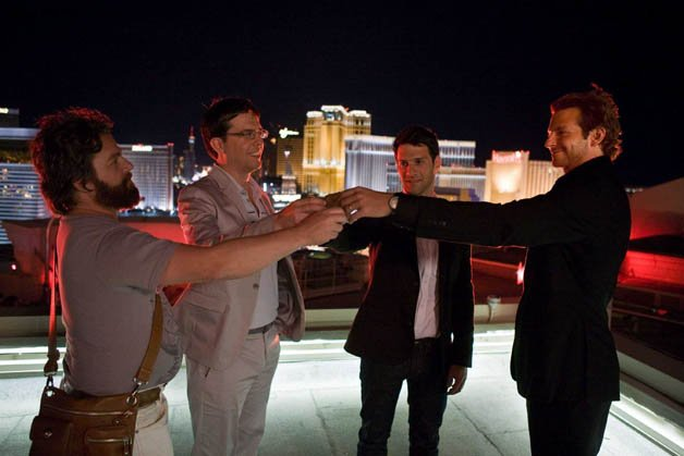 """(L-r) Alan (ZACH GALIFIANAKIS), Stu (ED HELMS), Doug (JUSTIN BARTHA) and Phil (BRADLEY COOPER) raise a toast on the rooftop to commence Doug's bachelor party in Warner Bros. Pictures' and Legendary Pictures' comedy """"The Hangover,"""" a Warner Bros. Pictures release. PHOTOGRAPHS TO BE USED SOLELY FOR ADVERTISING, PROMOTIONAL, PUBLICITY OR REVIEWS OF THIS SPECIFIC MOTION PICTURE AND TO REMAIN THE PROPERTY OF THE STUDIO. NOT FOR SALE OR REDISTRIBUTION."""