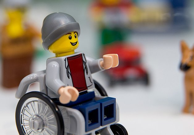 A Lego figure in a wheelchair is pictured at the Lego booth on January 28, 2016 in Nuernberg during the 67th International Toy Fair.  / AFP / dpa / Daniel Karmann / Germany OUT        (Photo credit should read DANIEL KARMANN/AFP/Getty Images)