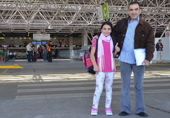 Pelo espírito olímpico,  jovem refugiada síria carrega  a tocha olímpica em Brasília