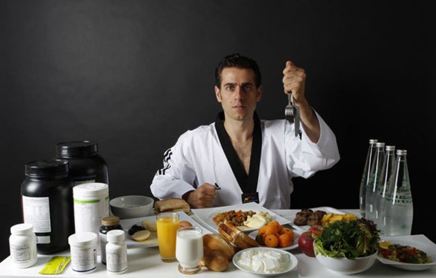 Turkish Taekwondo fighter and Olympic hopeful Bahri Tanrikulu poses in front of his daily nutrition in Ankara