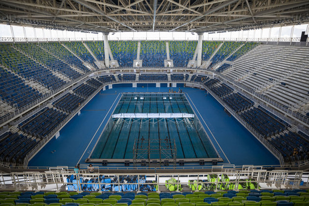 FILE - This April 4, 2016 file photo shows the inside of the Olympic Aquatics Stadium during a foreign media tour inside Olympic Park in Rio de Janeiro, Brazil. Problems still hang over South America's first games. Brazil President Dilma Rousseff is being impeached and is likely to be suspended when the games open Aug. 5, partly fallout from Brazil's worst recession in decades, 10-percent unemployment, and a $3 billion Petrobras corruption scandal. Away from politics, the Zika virus threatens athletes and tourists. (AP Photo/Felipe Dana)