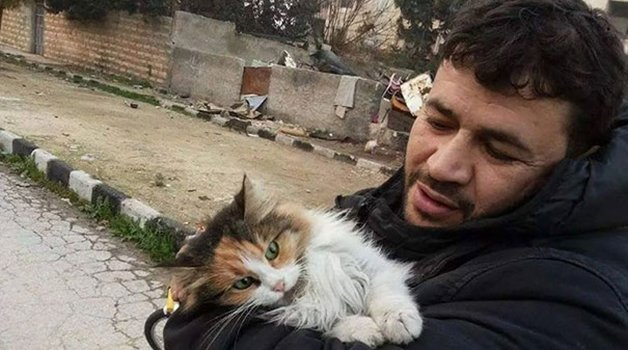 cat-man-aleppo-syria-1