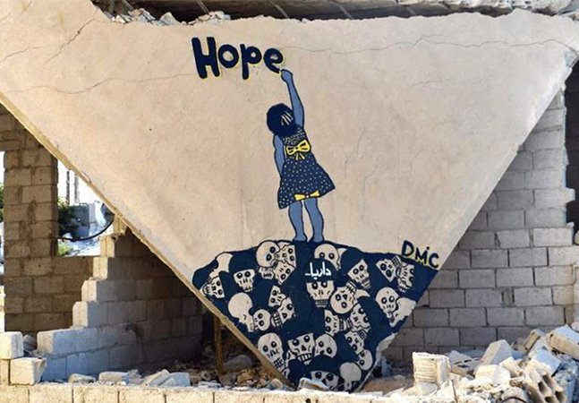 """Jovem usa arte de rua em Damasco como arma contra a guerra e ganha o apelido de """"Banksy da Síria"""""""