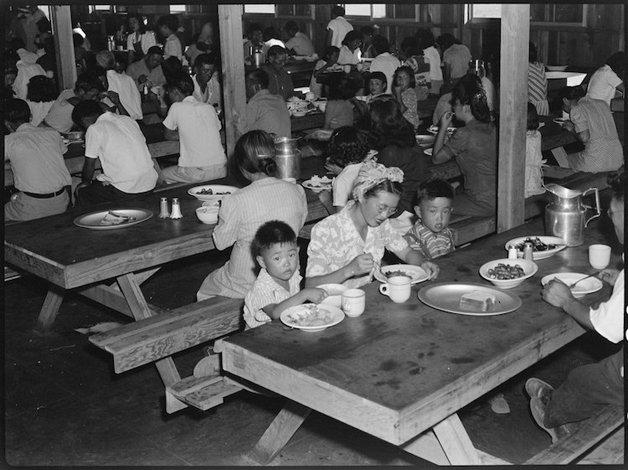Manzanar Relocation Center, Manzanar, California. Mealtime in on