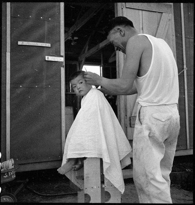 Manzanar Relocation Center, Manzanar, California. Little evacuee