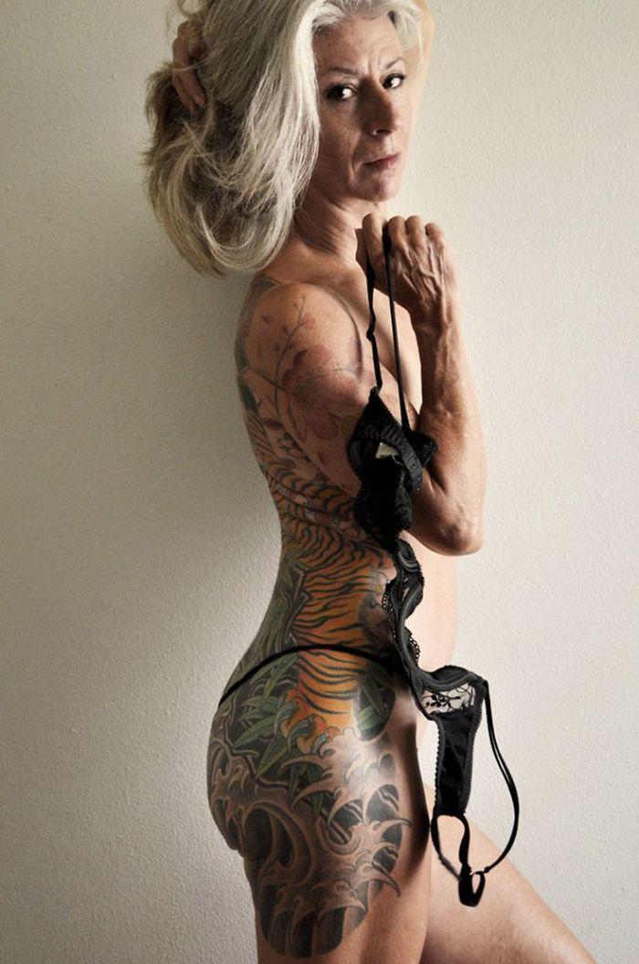 56-year-woman-body-piercing-tattoo-julie-burning-lotus-1-58b3dc21be4d6__700