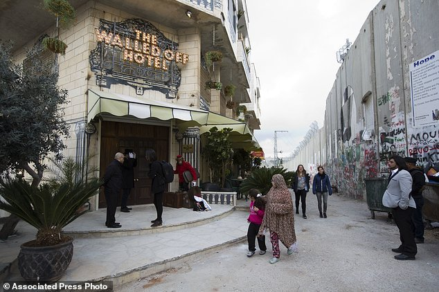 Palestinians Banksy