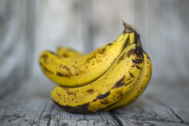 57442355 - wood background with overripe bananas