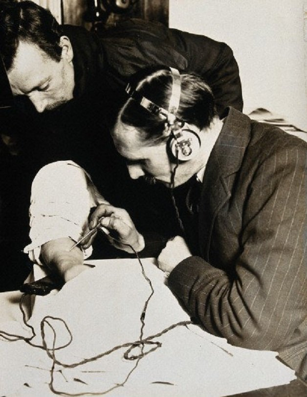 Surgery-using-a-telephone-probe-to-locate-a-bullet