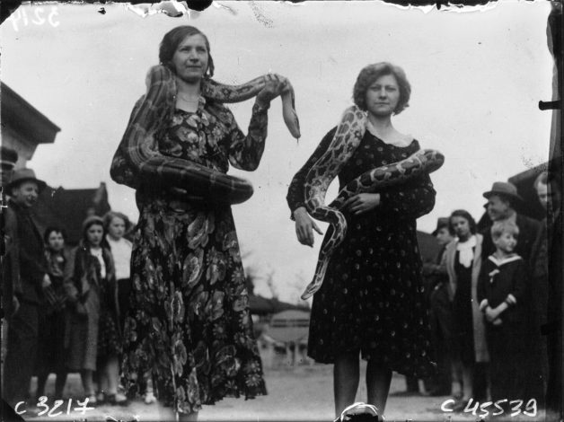 Two-women-with-their-snakes