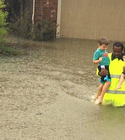 Homem resgata duas crianças no meio do furacão e a imagem viraliza pelo melhor motivo