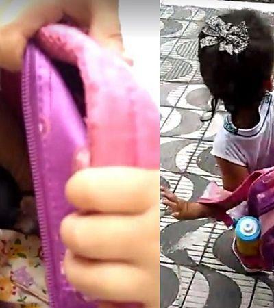Menina tenta levar cachorro na mochila para a escola, é descoberta e finge que nada aconteceu