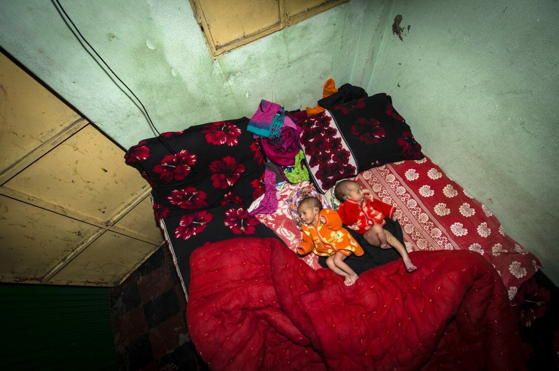 Five days old twins lie on the bed. They have not yet a name. Jhinik, 20 years, a sexworker in the Kandapara brothel gave birth to them.