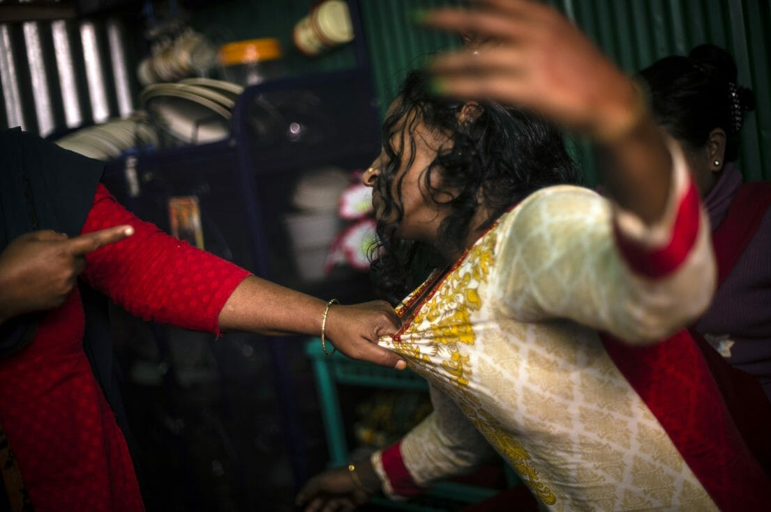 Bonna, 27, a sexworker in the Kandapara brothel in Tangail, is fighting with another woman.