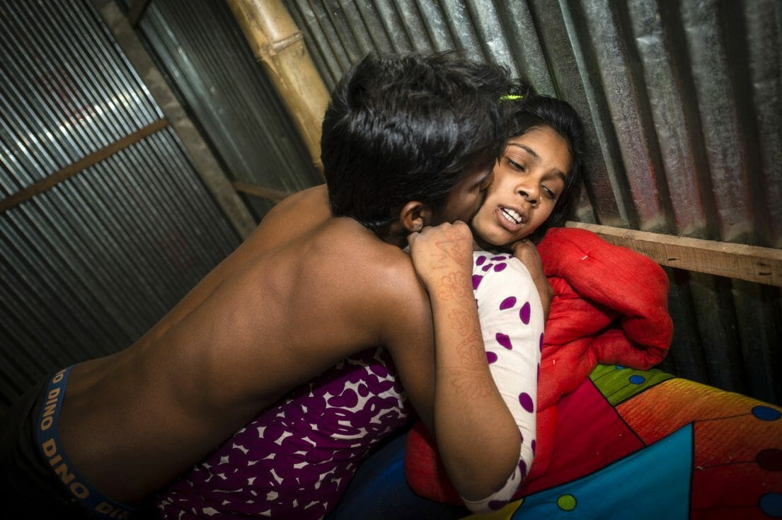 Pakhi, 15 years, with a customer in her room in the Kandapara brothel in Tangail. He came in a group of five men who all wanted to have sex with her one after another. These men left the room because they were too drunk. The man in the picture also left the room after this photo. The main reason was because Pakhi didn´t like him. But also because I was in the room.