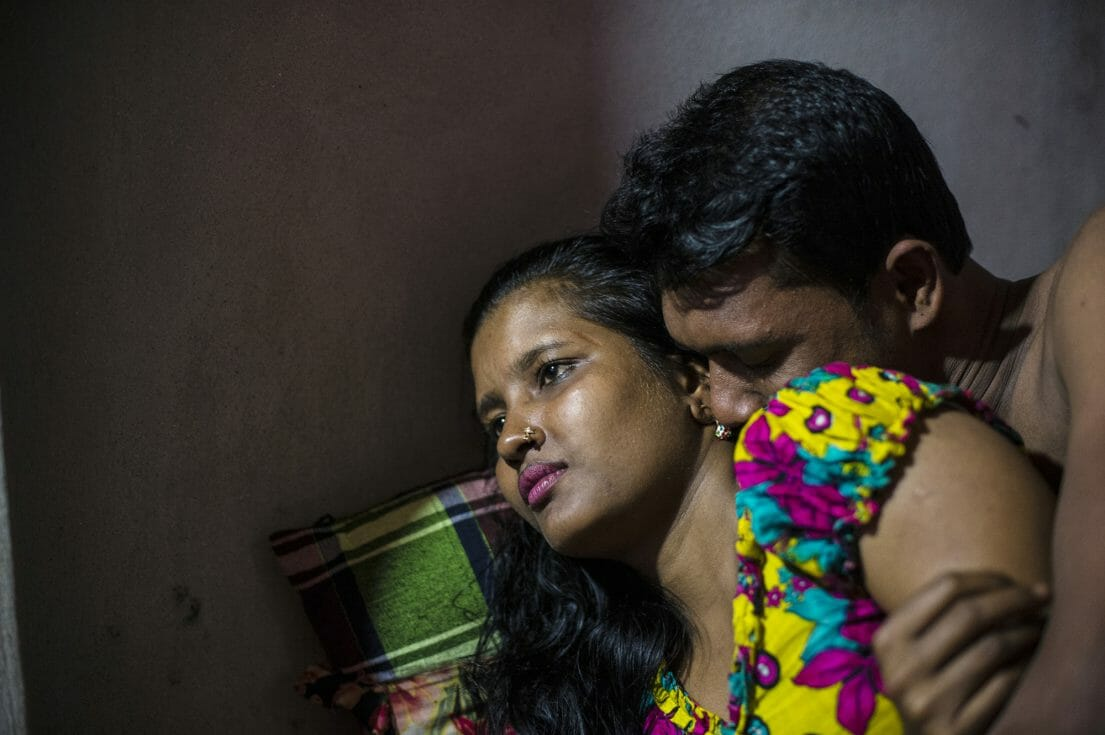 Meghla, 23, with a customer in the Kandapara brothel in Tangail. She started working for a garment factory when she was 12 years old. There that she met a man who promised her a better job with more money and he sold her into a brothel.