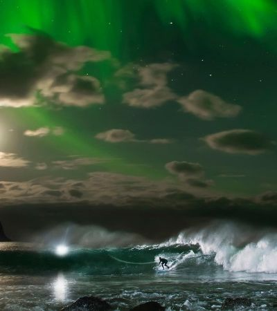 Escola de surf na Noruega tem neve, aurora boreal e temperaturas negativas