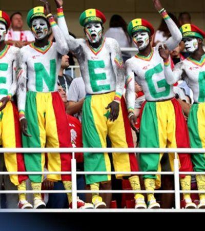 Senegaleses limpam estádio após vitória histórica na Rússia