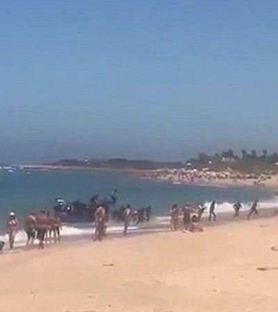 Vídeo mostra dezenas de imigrantes desembarcando em praia na Espanha