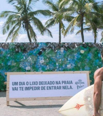 Contra poluição de oceanos, cervejaria Corona bloqueia praia de Ipanema com 'muro de lixo'
