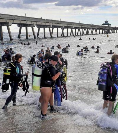 Mergulhadores retiram 1,5 tonelada de lixo do mar e quebram recorde