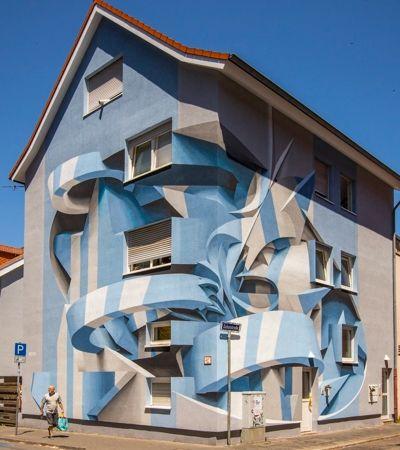 Grafiteiro cria ilusões de óptica incríveis em prédios e casas