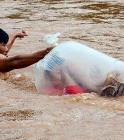 Crianças usam saco plástico para cruzar rio e chegar em escola no Vietnã