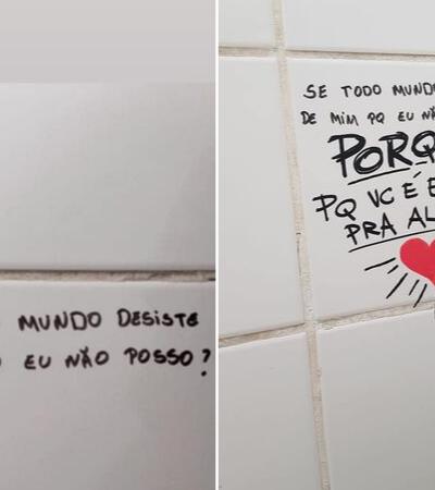 Grafiteiro transforma mensagens tristes de banheiro de escola em esperança