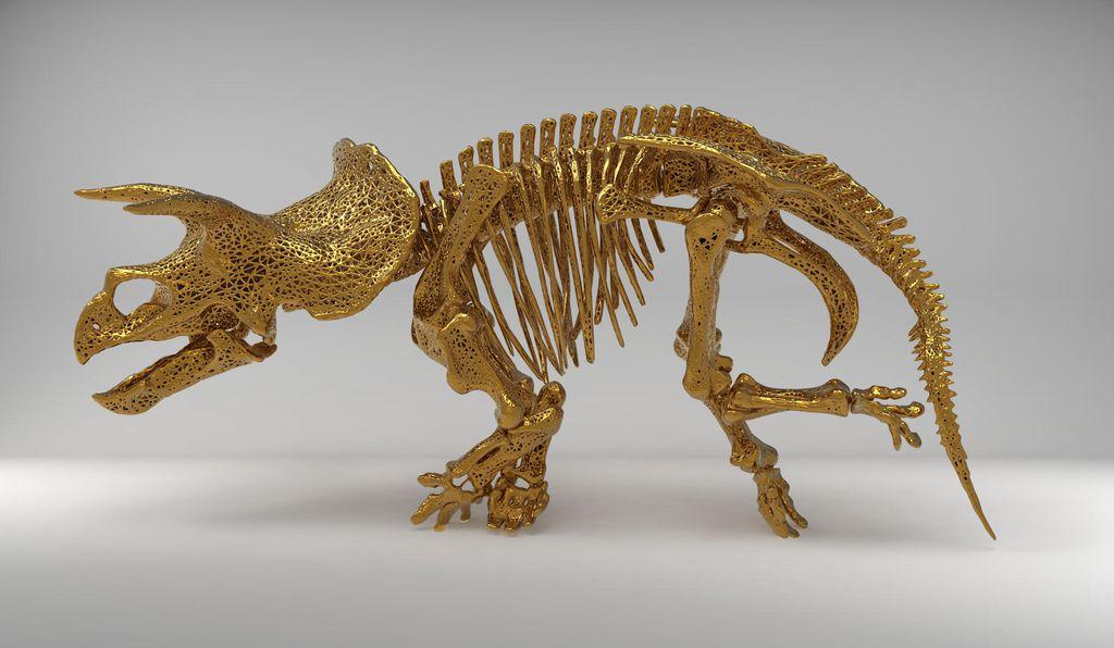 Escultura dourada de um esqueleto de dinossauro