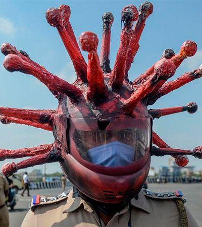 Índia: policial usa 'capacete de coronavírus' para que pessoas fiquem em casa
