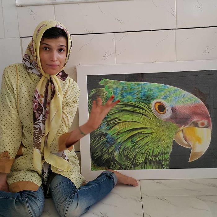 artista deficiente pinta com pés 2