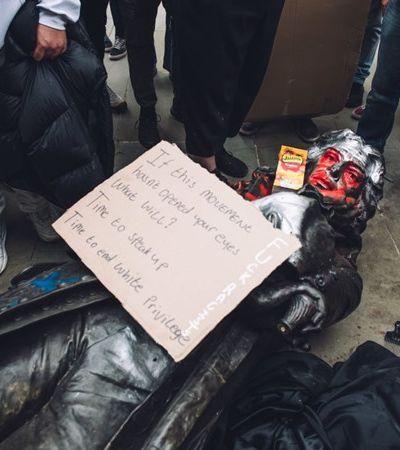 Antirracistas jogam no rio estátua de comerciante de escravizados e prefeito defende ato