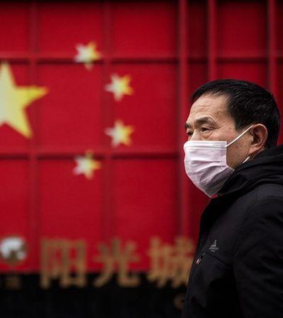 China diz que controlou surto de coronavírus iniciado em tábua de cortar salmão em mercado
