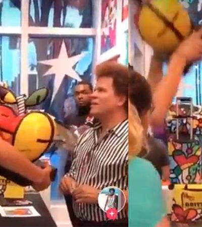 Mulher quebra obra de R$ 26 mil de Romero Britto na frente dele e acusa artista de maltratar funcionários