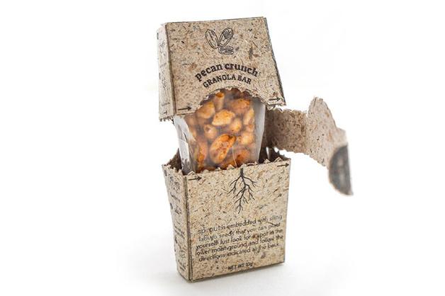 A embalagem feita de abacaxi com uma barra de cereal dentro