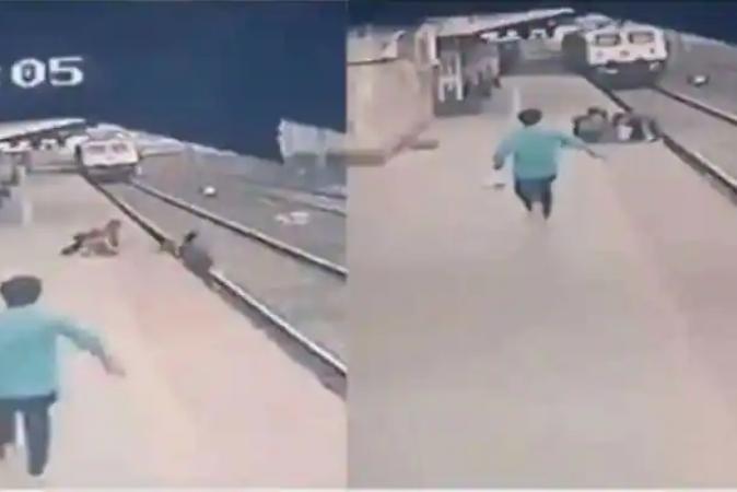 Homem é recompensado por pular nos trilhos para salvar criança de trem; veja vídeo