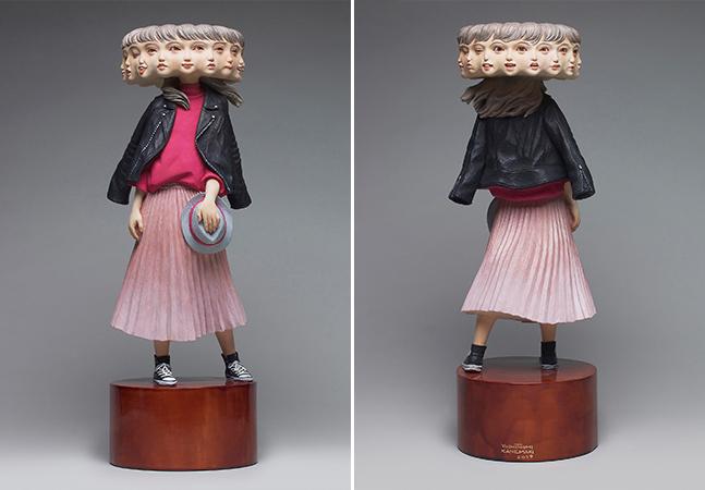 Esculturas de madeira expressam a ambivalência e os sentimentos contraditórios da vida moderna