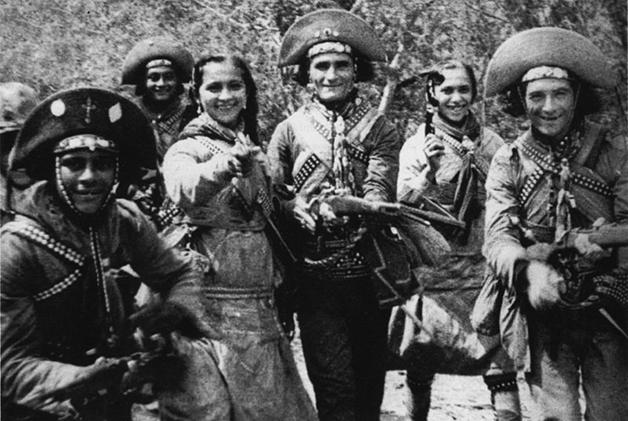 Durvinha, à esquerda com a arma na mão, na clássica cena do filme